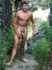Nico discovers Genadij sitting on rocks having a quiet wank, so he strips off and joins him